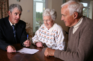 Picture of couple discussing estate planning